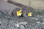 Plush Towels with Complimentary Flower Bath
